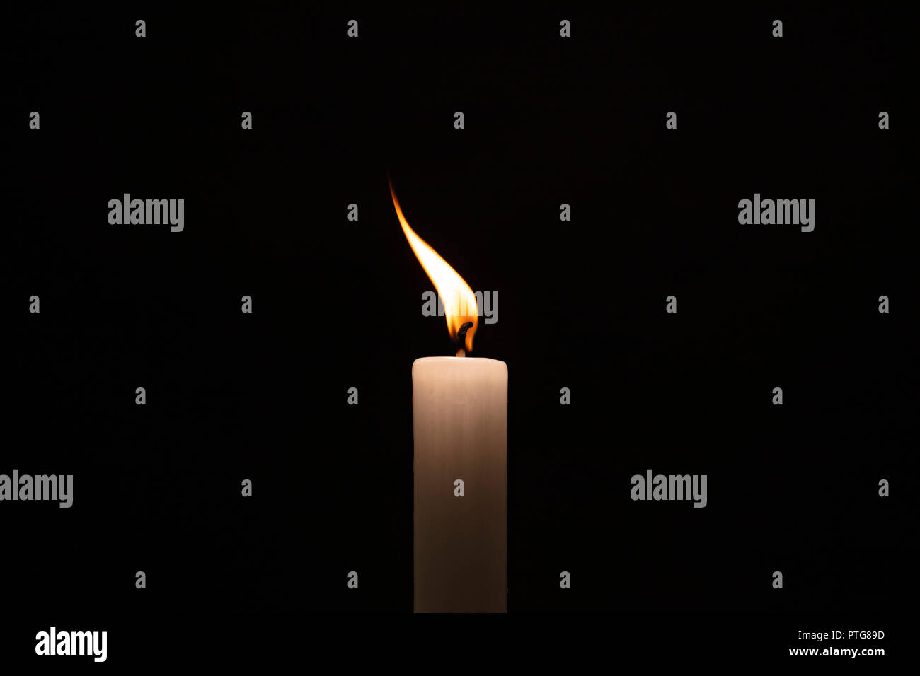 White Candle with flame, weiße Kerze - Stock Image