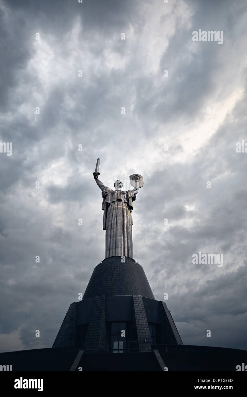 Mother Motherland statue at grey cloudy sky background in Kiev, Ukraine - Stock Image
