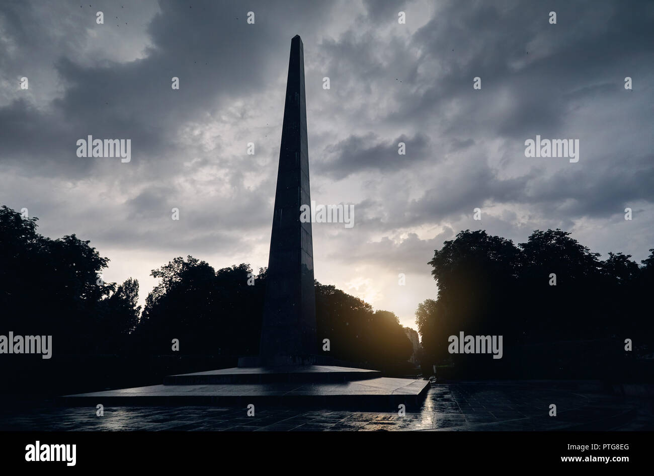 Pillar monument at cloudy sky in the Park of Eternal Glory in Kiev, Ukraine - Stock Image