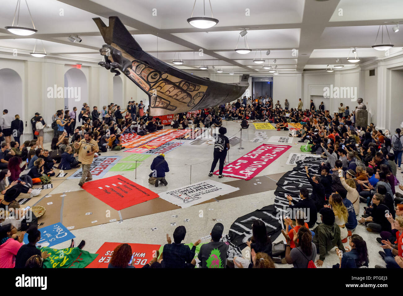 """New York, United States. 08th Oct, 2018. Activists from New York's Indigenous and Black communities, along with decolonial advocates led the 3rd annual """"Anti-Columbus Day Tour"""" at the American Museum of Natural History on October 8, 2018; the groups are demanding that Mayor de Blasio and members of the New York City Council join the growing list of cities in the U.S. that have renamed Columbus Day as Indigenous Peoples' Day and for the removal of Theodore Roosevelt's statue. Credit: Erik McGregor/Pacific Press/Alamy Live News Stock Photo"""