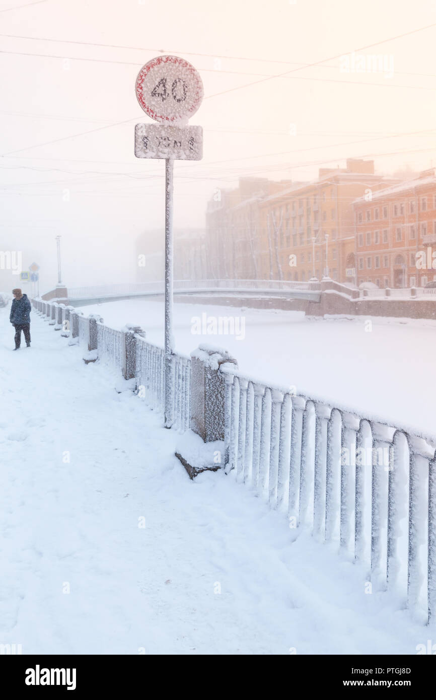 Frosted speed limit road sign on the coast of Griboedov canal in winter season. Saint Petersburg, Russia - Stock Image