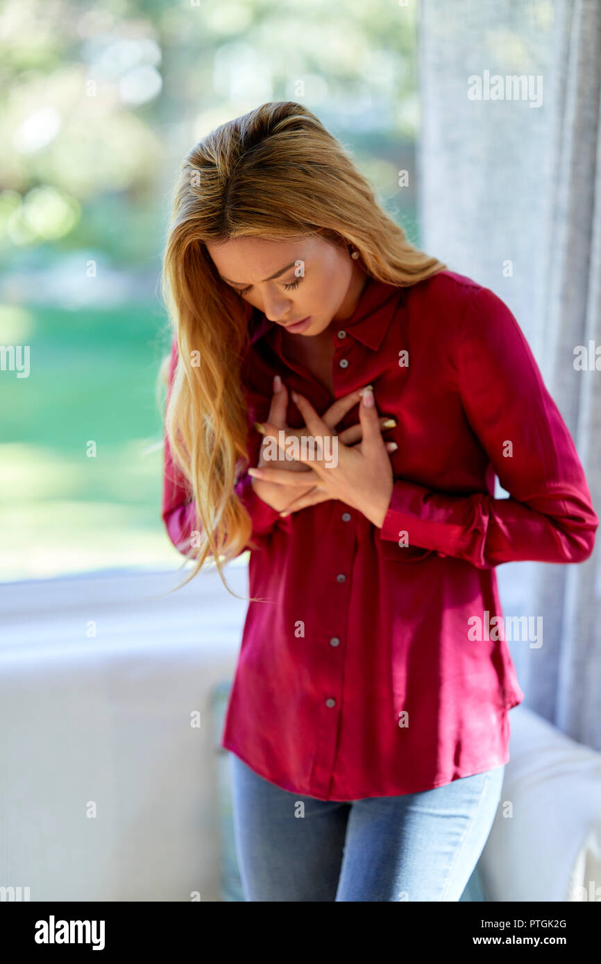 Woman with chest pains - Stock Image