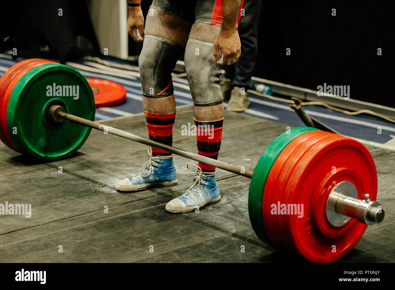 e3e5918415 powerlifter legs in gym chalk and knee sleeves competition deadlift ...