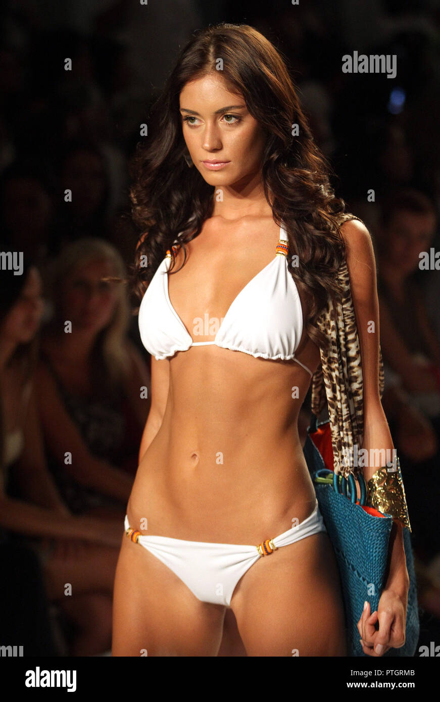 A model walks the runway during the Caffe Swimwear show at the 2012 Mercedes-Benz Fashion Week Swim, at the Raleigh Hotel in Miami Beach on July 16, 2011. - Stock Image