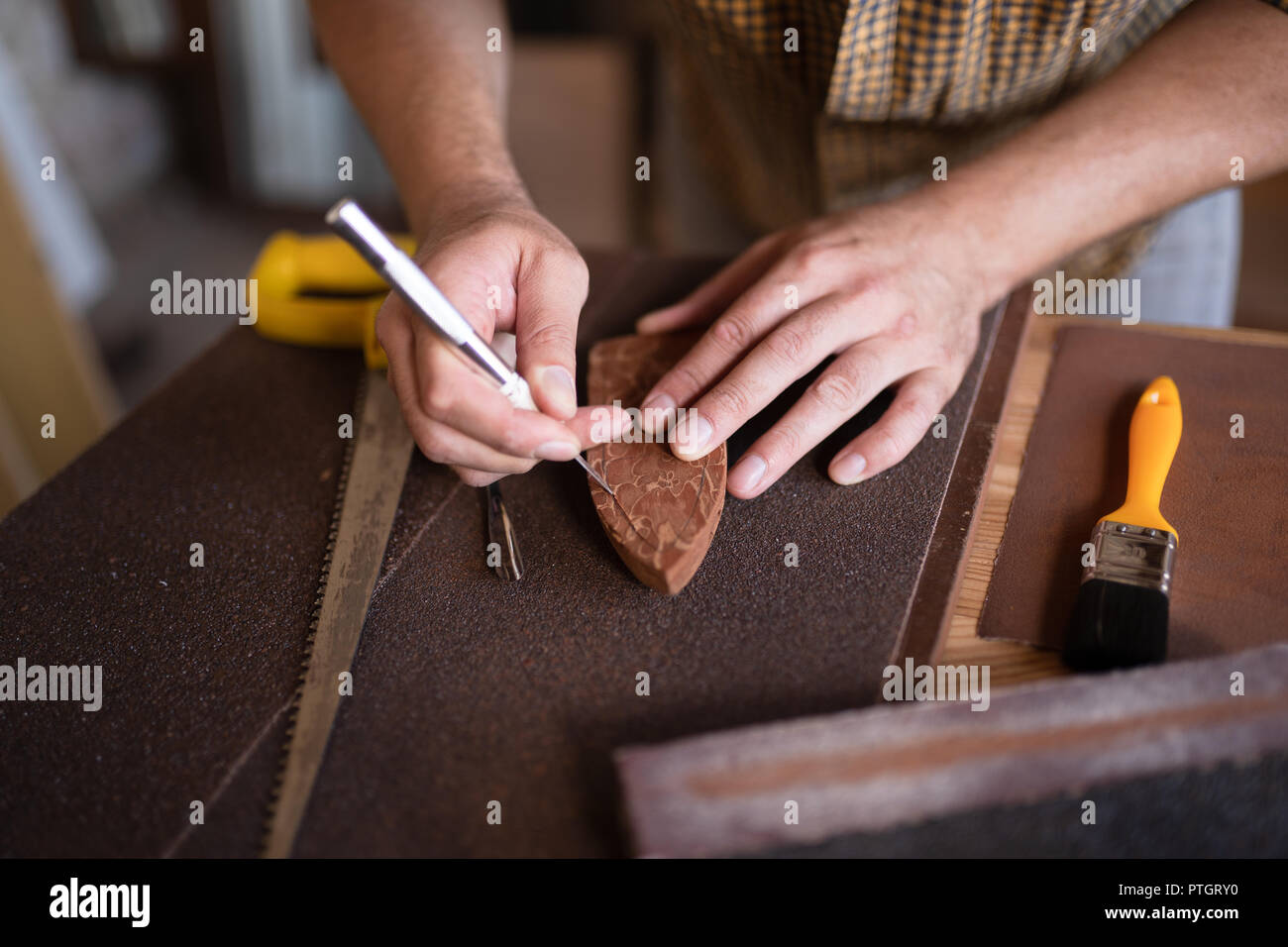 A joiner using his chisel - Stock Image