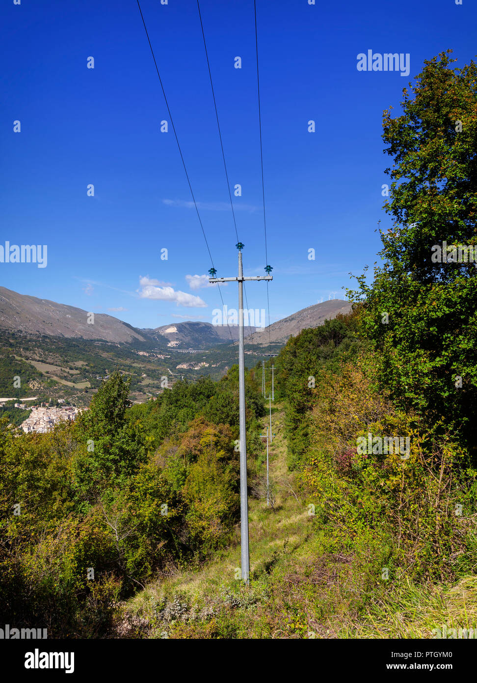 High tension electrical supply pylons in the Natural Reserve of the Gorges of the Sagittario (Riserva delle Gole del Sagittario) near Castrovalva,  a  - Stock Image