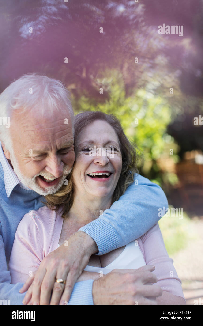 Affectionate, smiling senior couple hugging - Stock Image