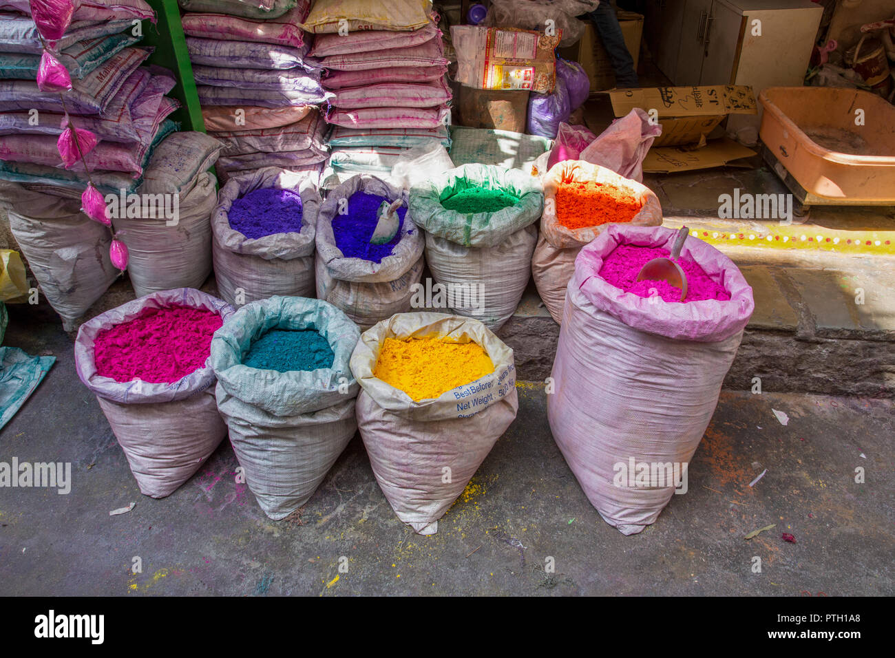 a stall selling paints and dyes at an Indian Market. Photographed in Ahmedabad, Gujarat, India - Stock Image