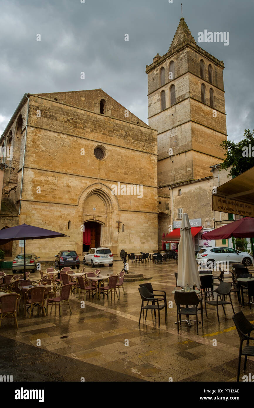 Mare de Deu dels Angels Parish Church after a downpour, Sineu, Mallorca, Spain. - Stock Image