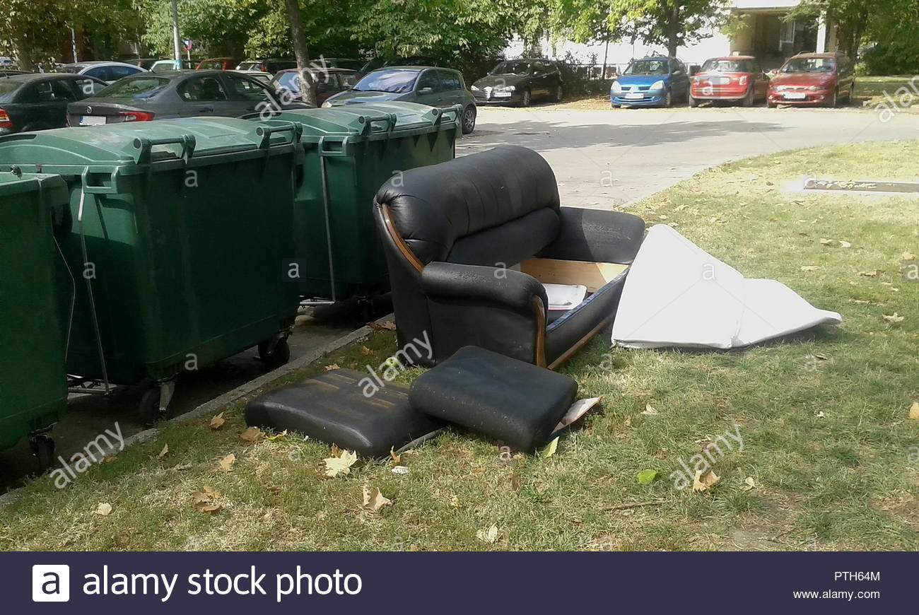 Novi Sad, Serbia, 30.09.2018 black gentlemanly expensive old bed with a white mattress thrown in the trash - Stock Image