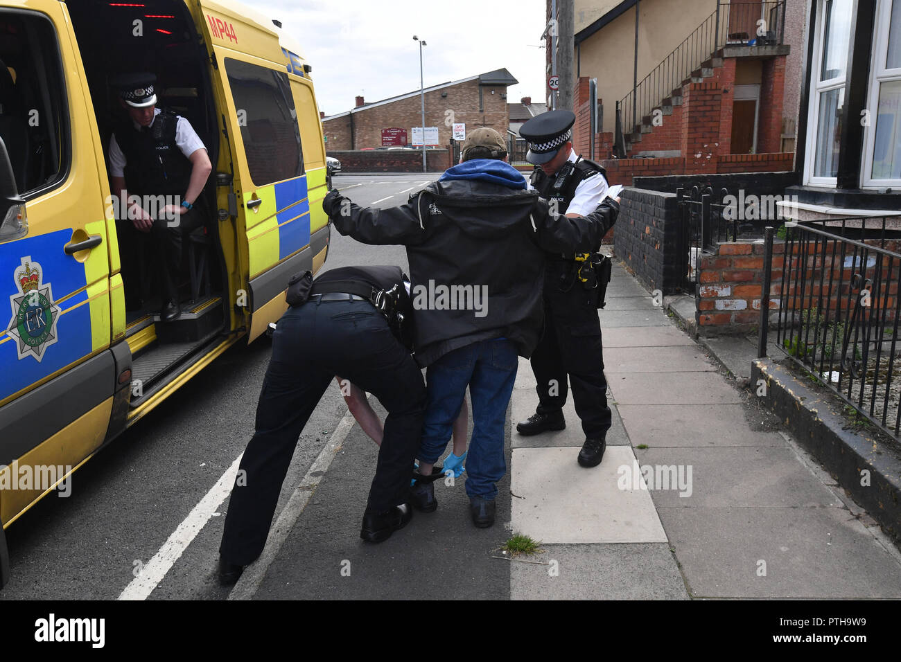 Merseyside Police officers carry out a Stop and Search in the Bootle area of Liverpool - Stock Image