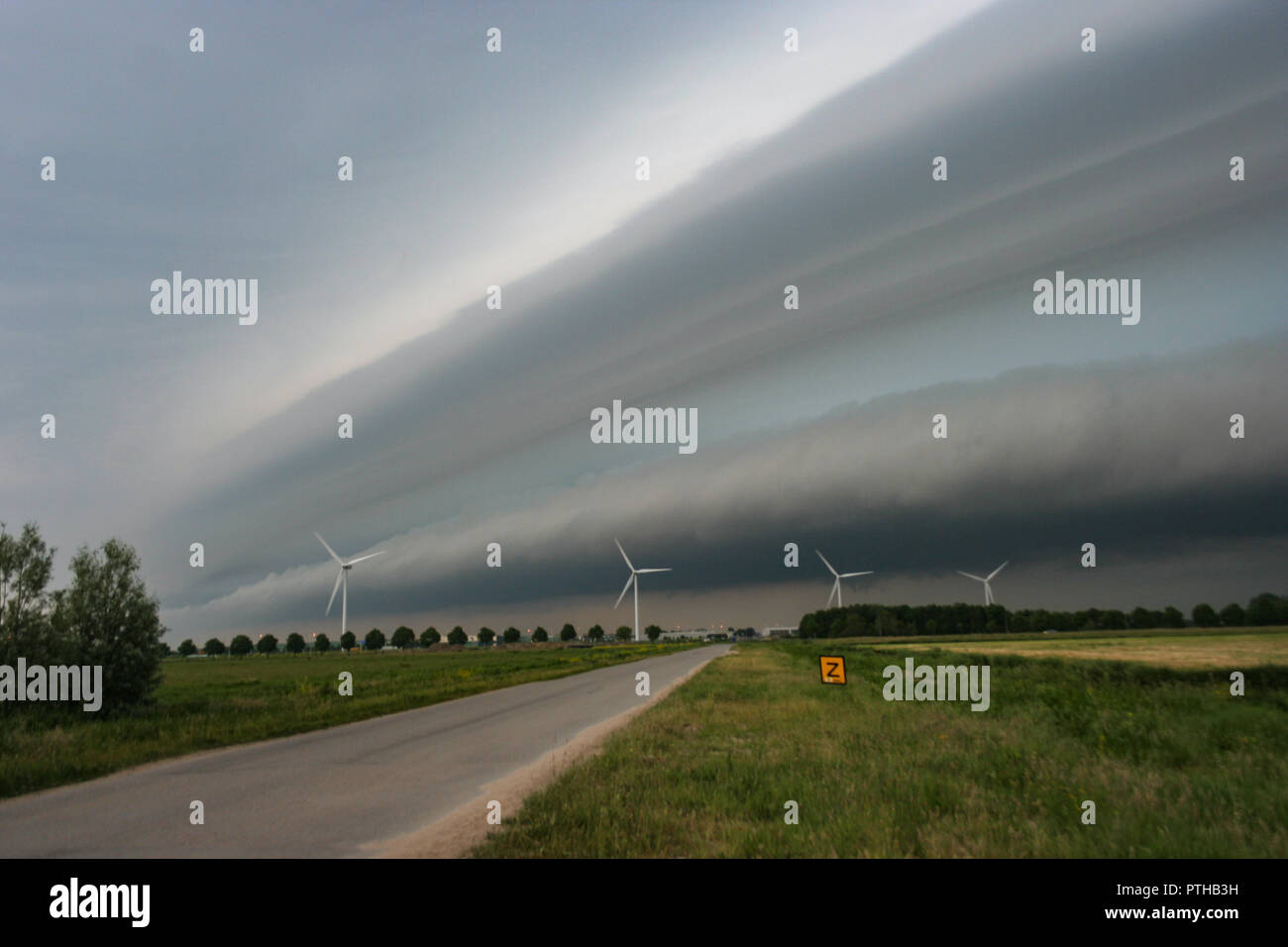 A multi layered shelfcloud causing bad weather in The Netherlands. - Stock Image
