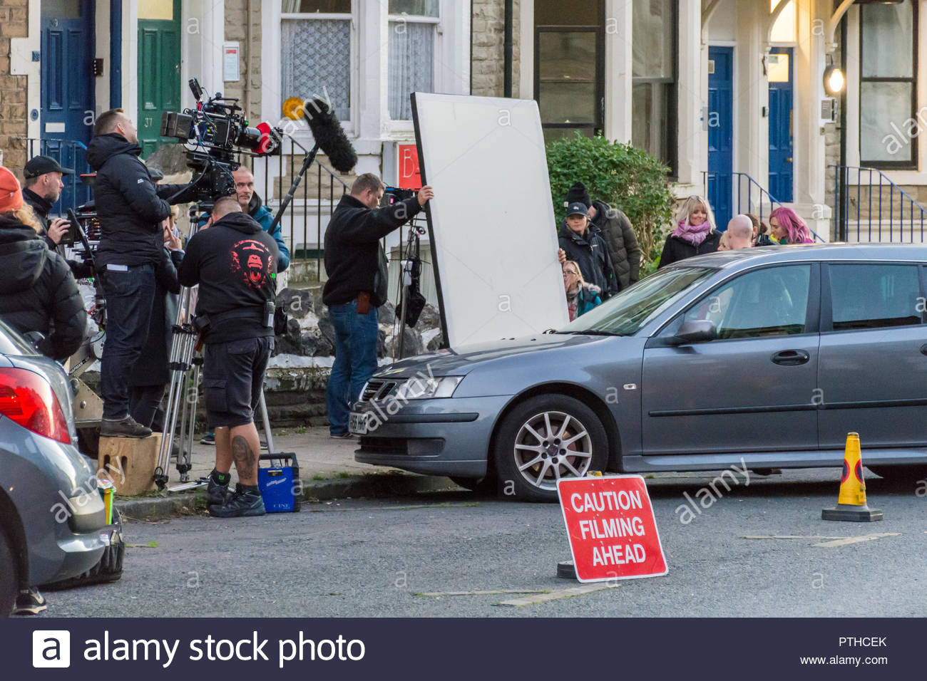 A film crew filming a new ITV crime drama 'The Bay' in locations around Morecambe and Heysham. Evening filming in West End Road - Stock Image