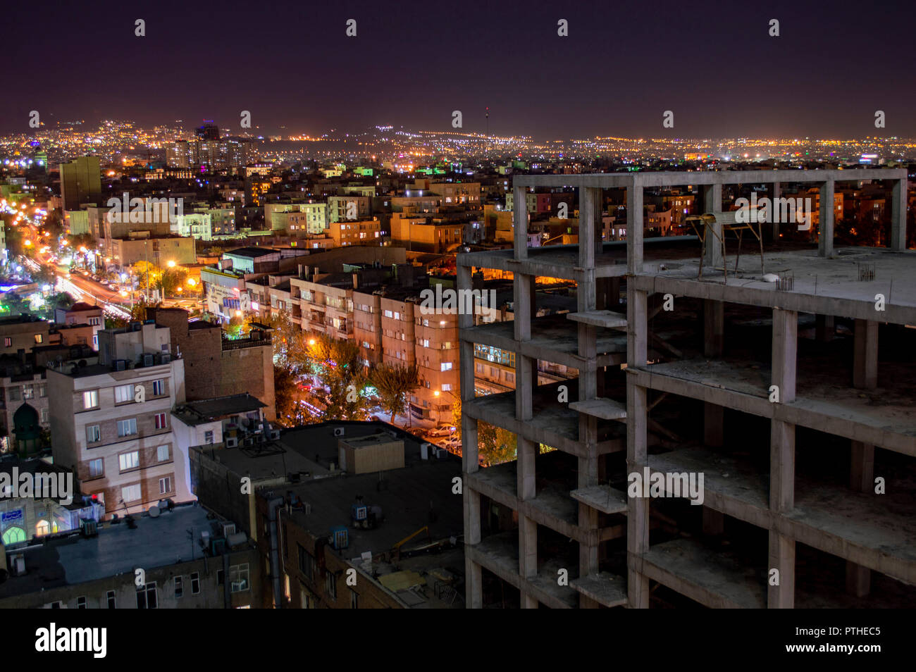 An incomplete building construction site in Tehran, Iran - Stock Image