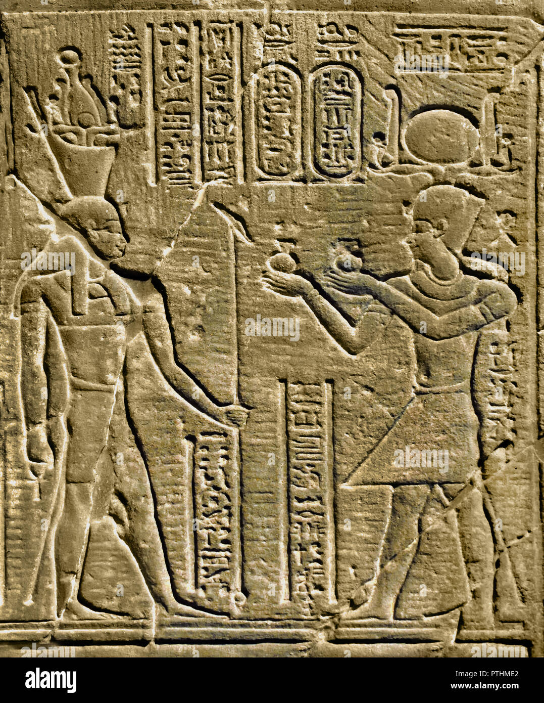 Temple relief shows the King offering wine before Geb, the Earth God 80-51 BC reign of Ptolemy XII (Ptolemaic Period). Egypt. - Stock Image