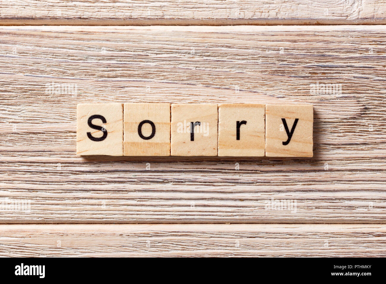 sorry word written on wood block. sorry text on table, concept. - Stock Image