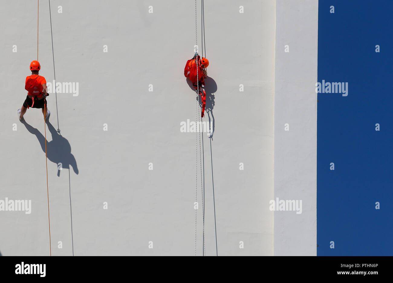 Palma de Mallorca / Spain - October 6, 2018: Abseiling on a building facade in the Spanish island of Mallorca. An abseil or also called a rapel or rap - Stock Image