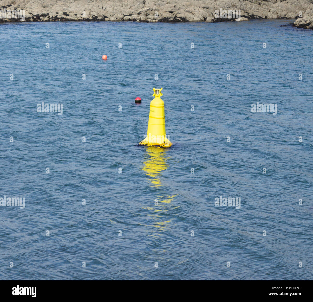 yellow coastal navigation markers showing or warning of an underwater outfall hazard - Stock Image
