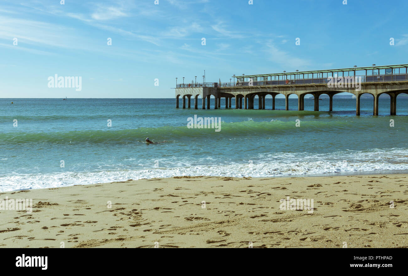 A view of Boscombe Pier in Bournemouth, UK. Waves breaking on the shoreline. Taken on 7th October 2018. Stock Photo