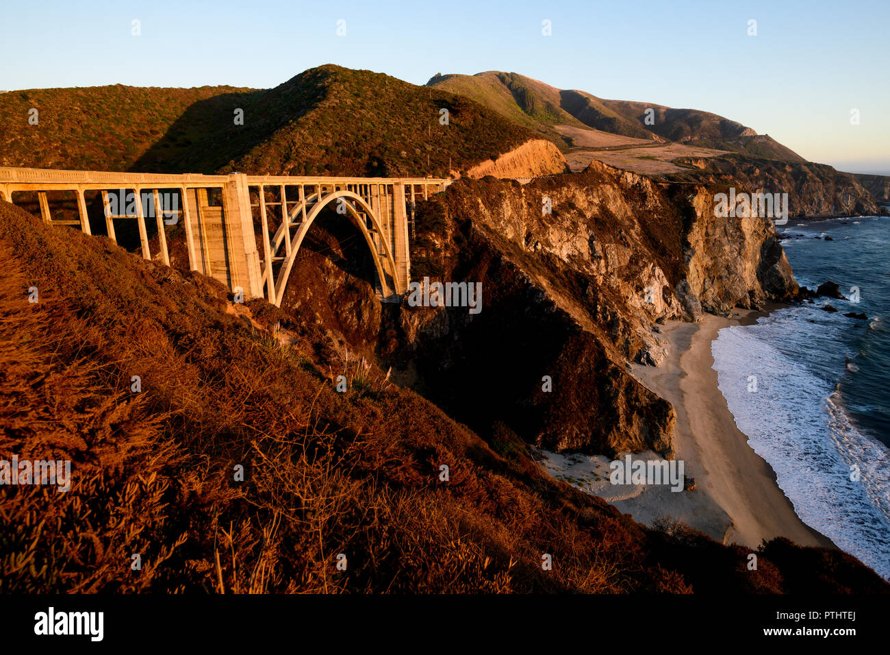 The famous Bixby bridge at sunset over the Pacific Ocean in fall along the Big Sur coastline on Highway 1, California, USA. - Stock Image