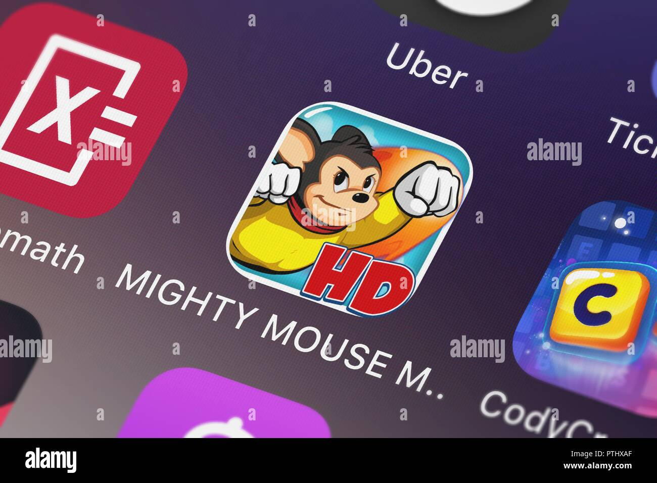 London, United Kingdom - October 09, 2018: Close-up shot of the MIGHTY MOUSE My Hero HD application icon from CBS Interactive on an iPhone. - Stock Image