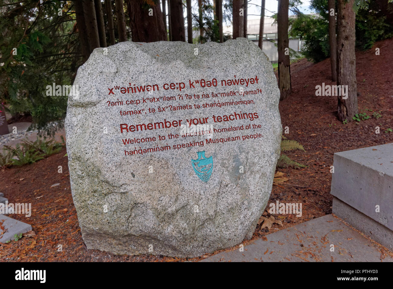 Musqueam people welcoming message carved on a boulder at the entrance to the UBC Museum of Anthropology, University of British Columbia, Vancouver, BC - Stock Image
