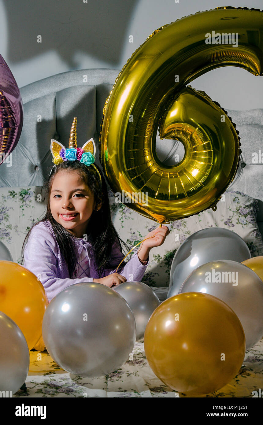 Happy Birthday To Me Girl Looking At The Camera With Balloons Around Her