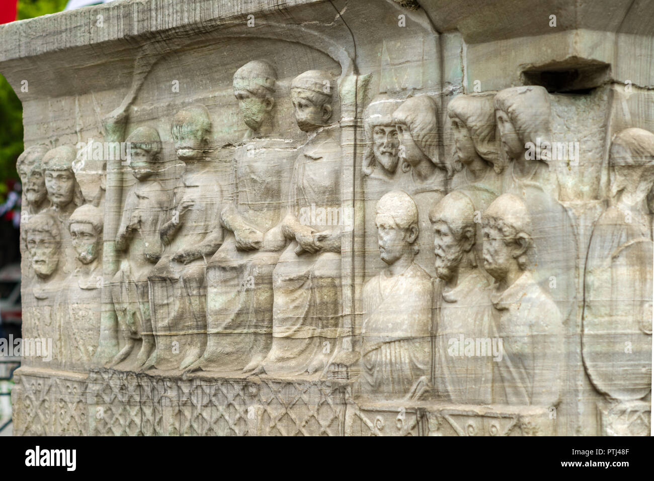 Detail of the pedestal of the Obelisk of Theodosius showing Submission of the barbarians on its West face, Istanbul, Turkey - Stock Image