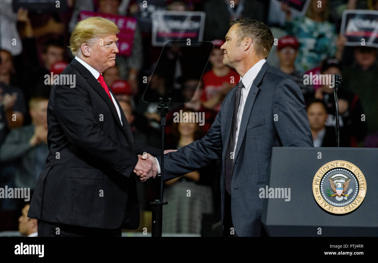 Kansas Secretary of State Kris Kobach who is the Republican candidate for governor at the conclusion of his speech at the MAGA rally gets a hug and some last minute words of advice from President Donald Trump  Topeka Kansas, USA, October 6, 2018 (Photo by Mark Reinstein/Corbis via Getty Images) Stock Photo