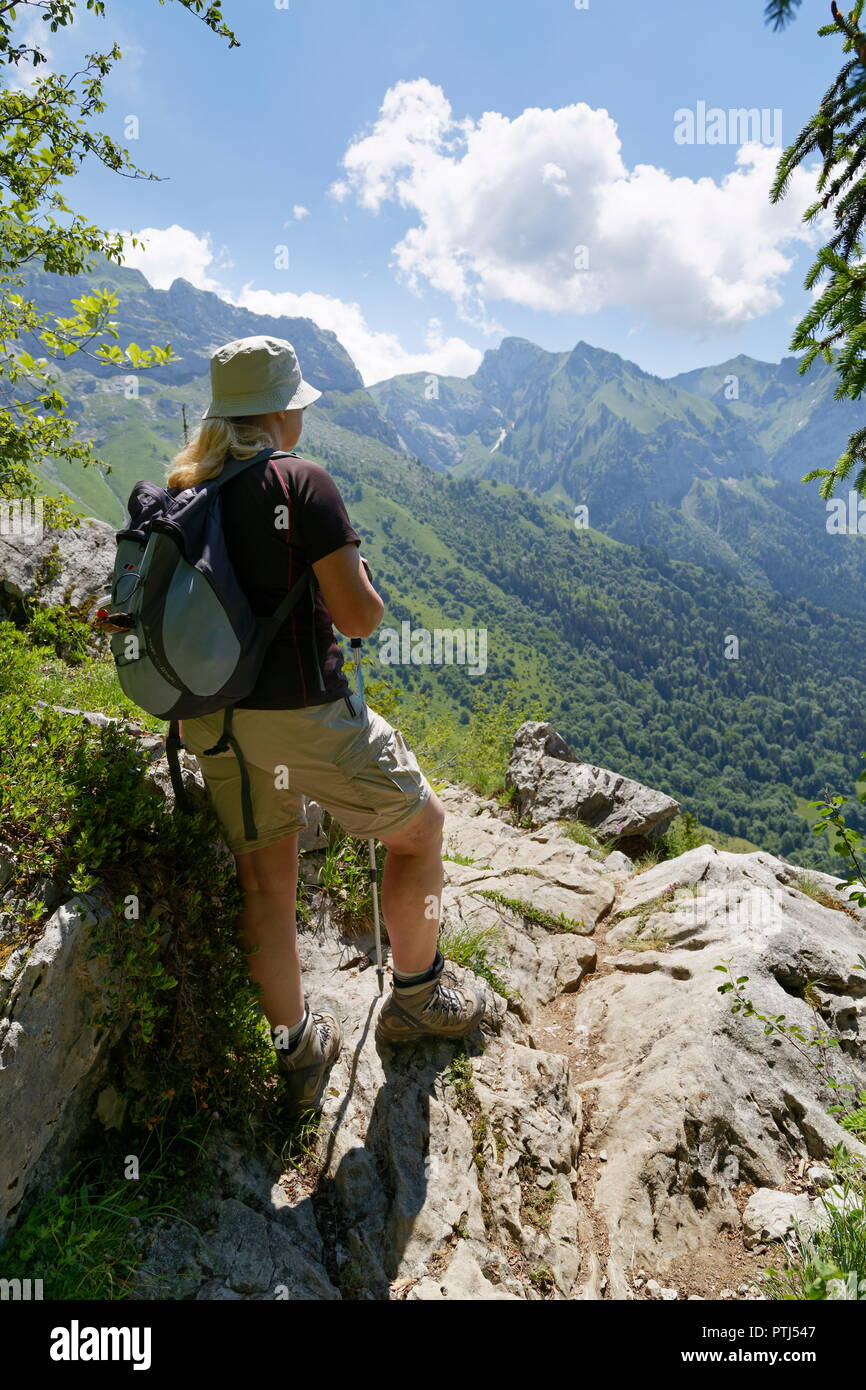 Female hiker at a look out point from a trail around Col de la Forclaz looking towards La Tourneete France - Stock Image
