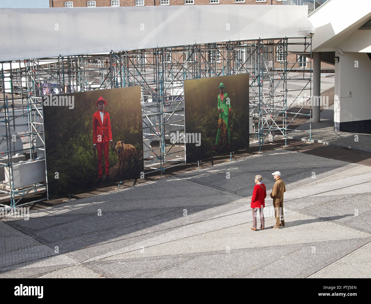 Two people enjoying contemporary photography at one of the outdoor exhibitions of Breda Photo, a bi-annual photography event in Breda, the Netherlands - Stock Image