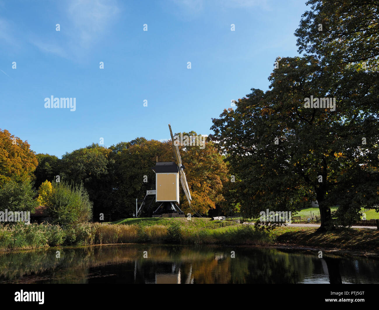 Old Dutch windmill of a specific type that is standing on a frame so the whole windmill can rotate photographed in the dutch open air museum in Arnhem - Stock Image