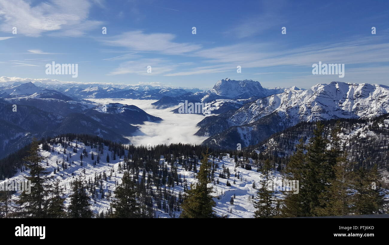 Image of ski resort with slopes in the mountains with low stratus over the valleys Stock Photo