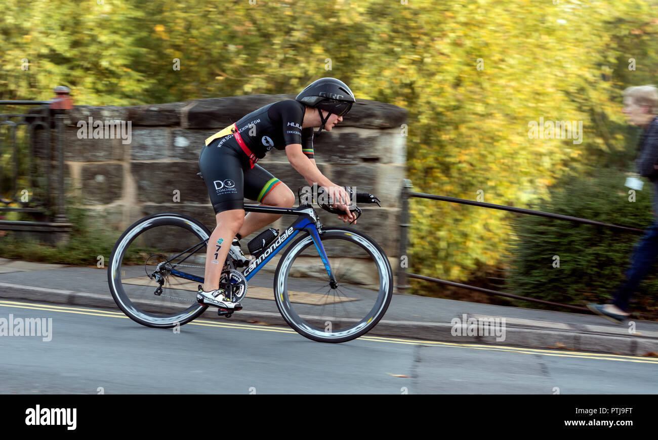 A cyclist crossing Clopton Bridge in the Warwickshire Triathlon Super Sprint, Stratford-upon-Avon, UK - Stock Image