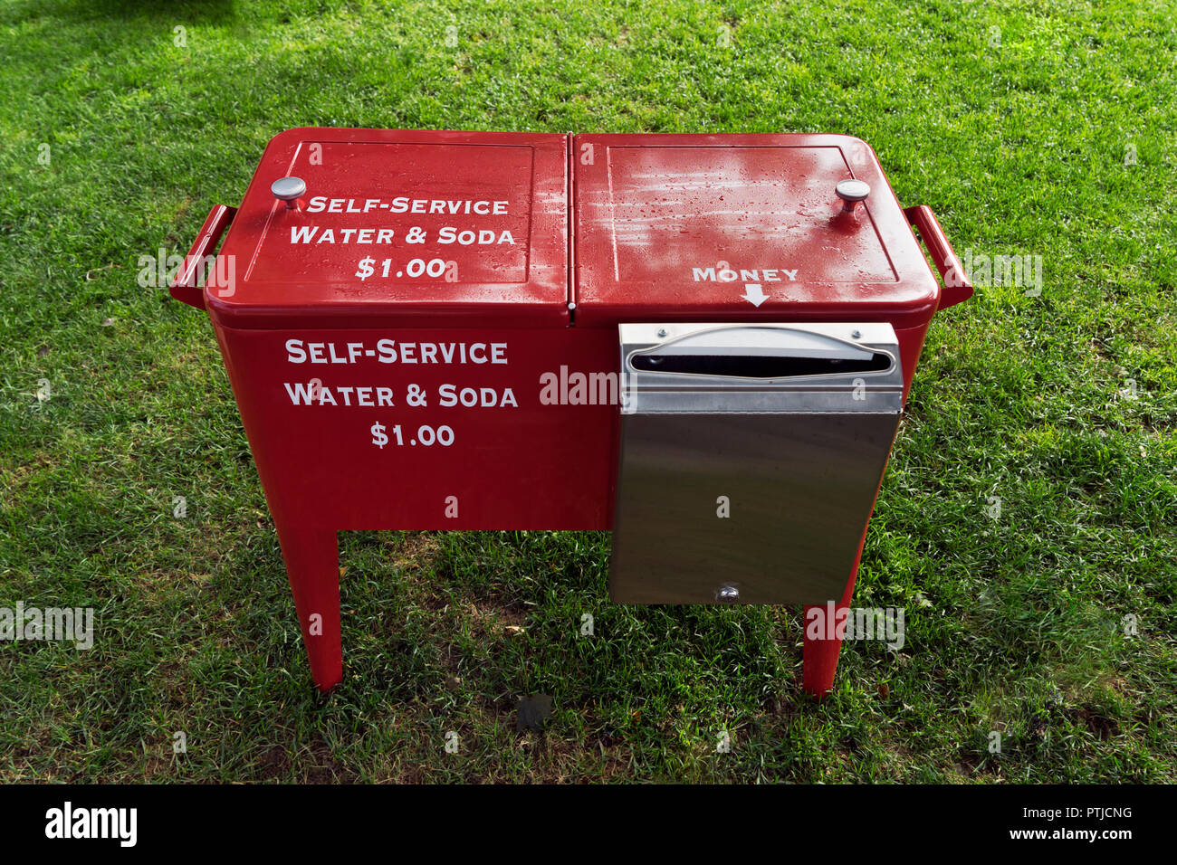 Red self-service water and soda dispenser. - Stock Image