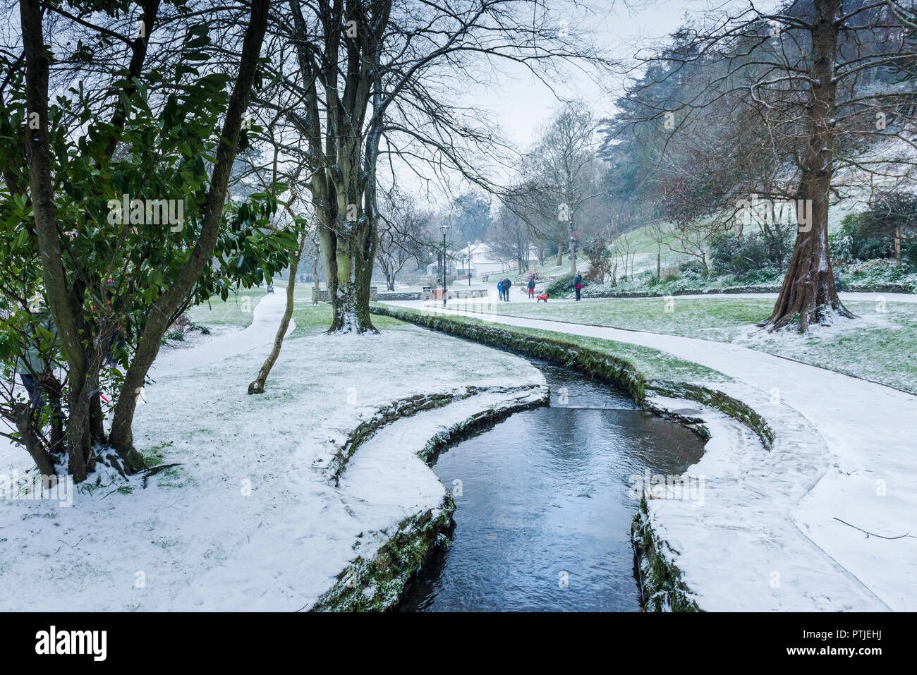 Snow falling in Trenance Gardens in Newquay in Cornwall. - Stock Image