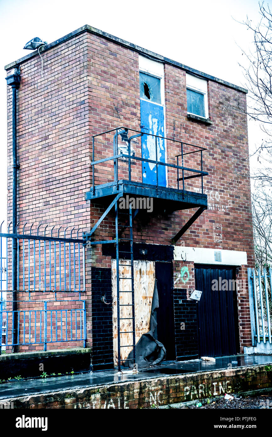Portrait shot of building remains, metal fire escape still intact. - Stock Image