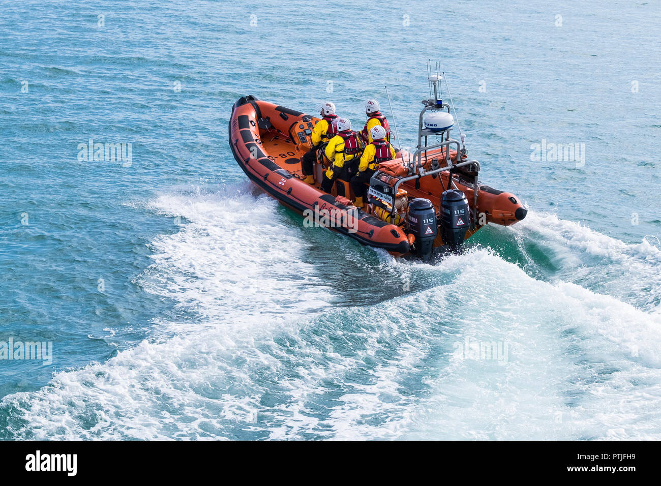 Volunteers of the Newquay RNLI crew participating in a GMICE Good Medicine in Challenging Environments major incident exercise in Newquay in Cornwall. - Stock Image