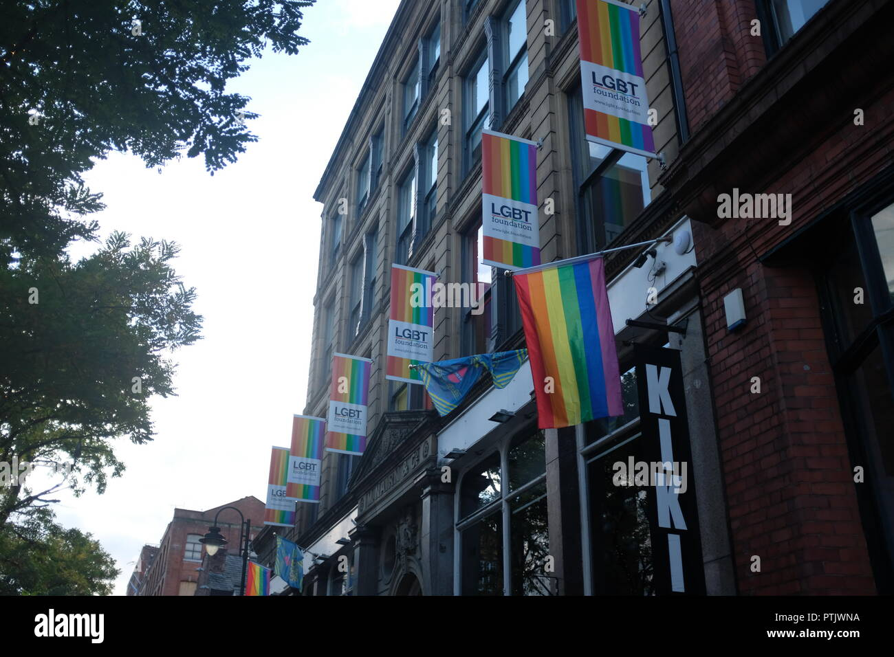 The LGBT flag outside a pub in gay village. - Stock Image