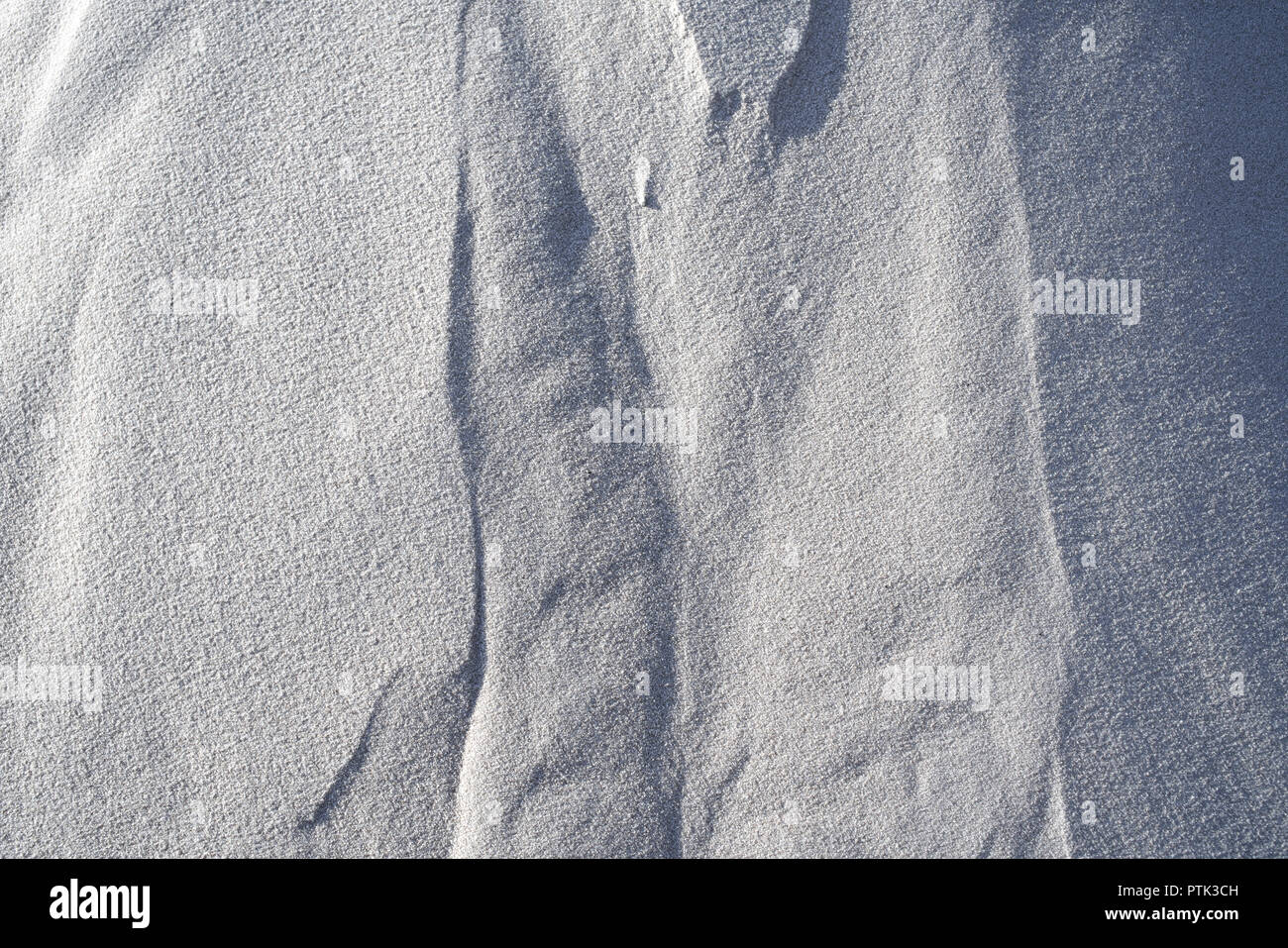 Detail of the raw material white quartz sand. - Stock Image