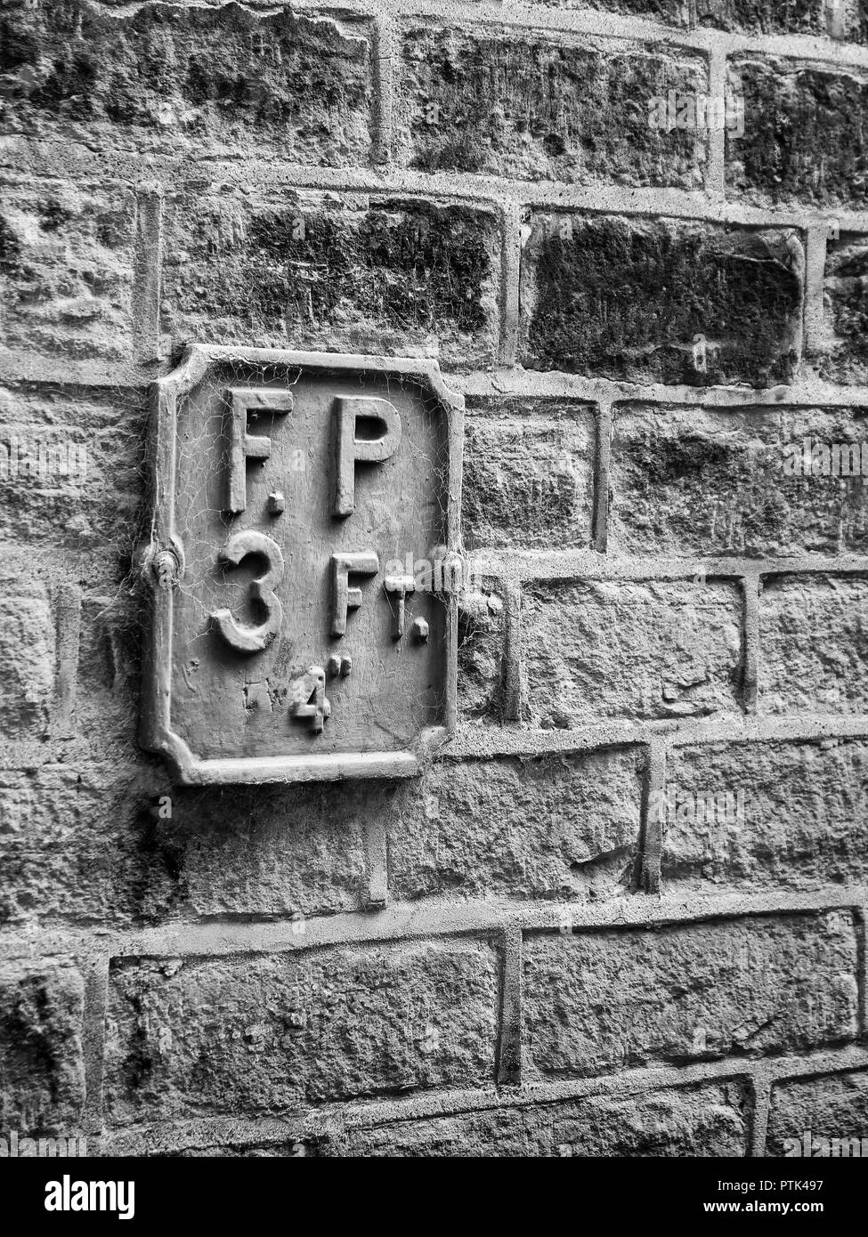 A historic fire point sign on a building at Saltaire, Bradford, Yorkshire - Stock Image