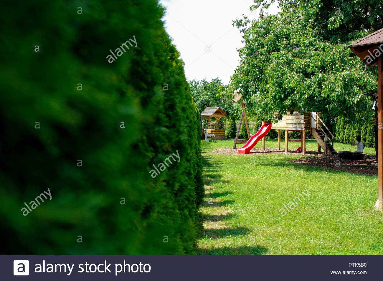 Playground in backyard,Backyard Play Structure - Stock Image - Backyard Play Area Stock Photos & Backyard Play Area Stock Images