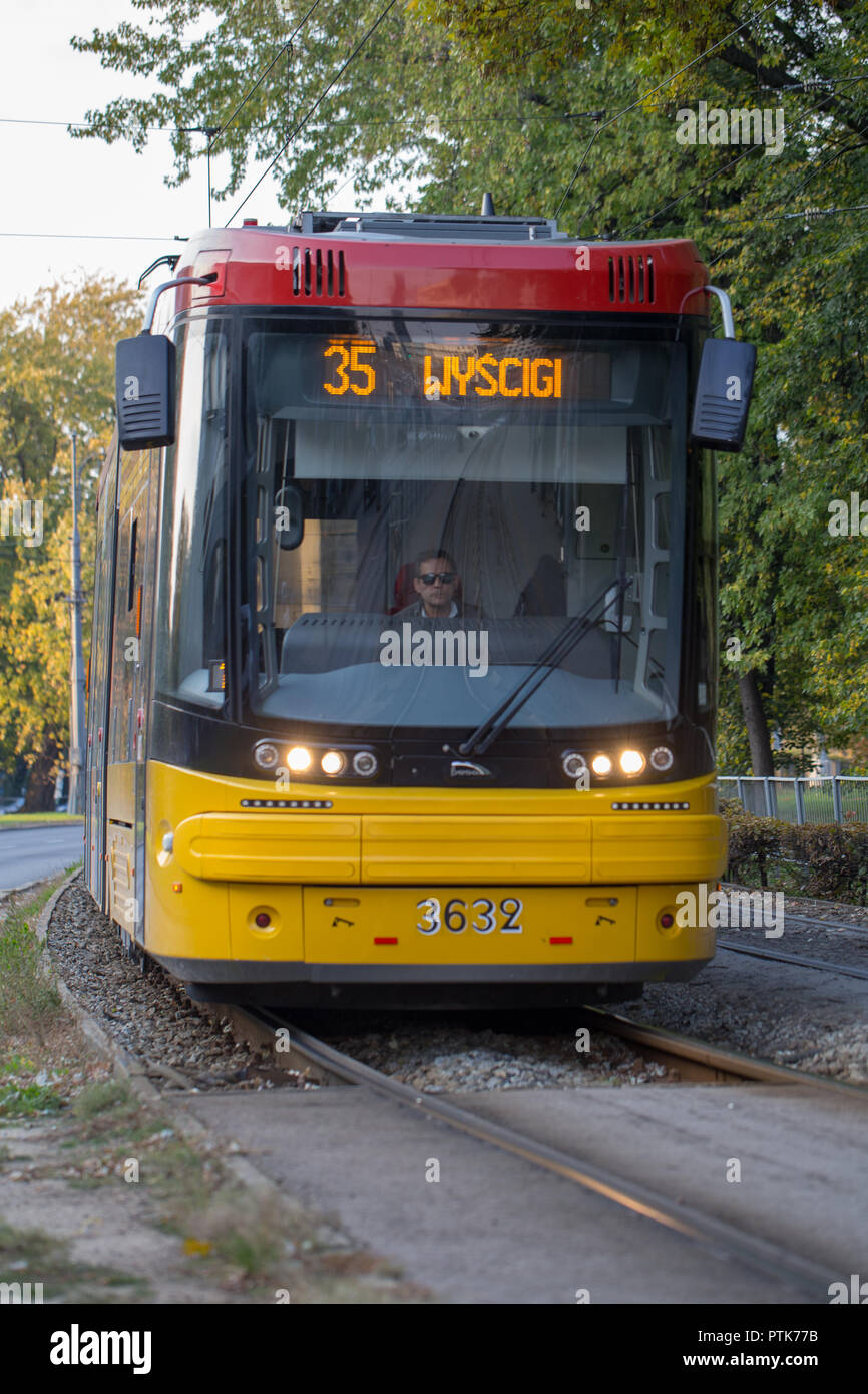 Yellow Pesa Jazz Duo 128N tram in Warsaw, Poland - Stock Image
