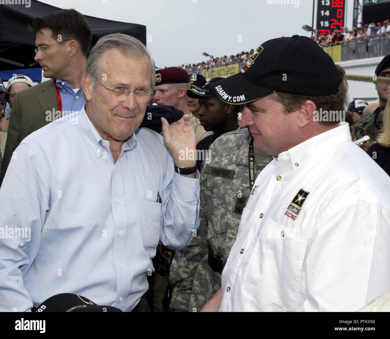 Secretary of Defense Donald Rumsfeld talks with Army sponcered driver Joe Nemechek in the garages prior to the running of the NASCAR Pepsi 400 , at Daytona International Speedway in Daytona Beach,  Florida, on July 2, 2005. - Stock Image
