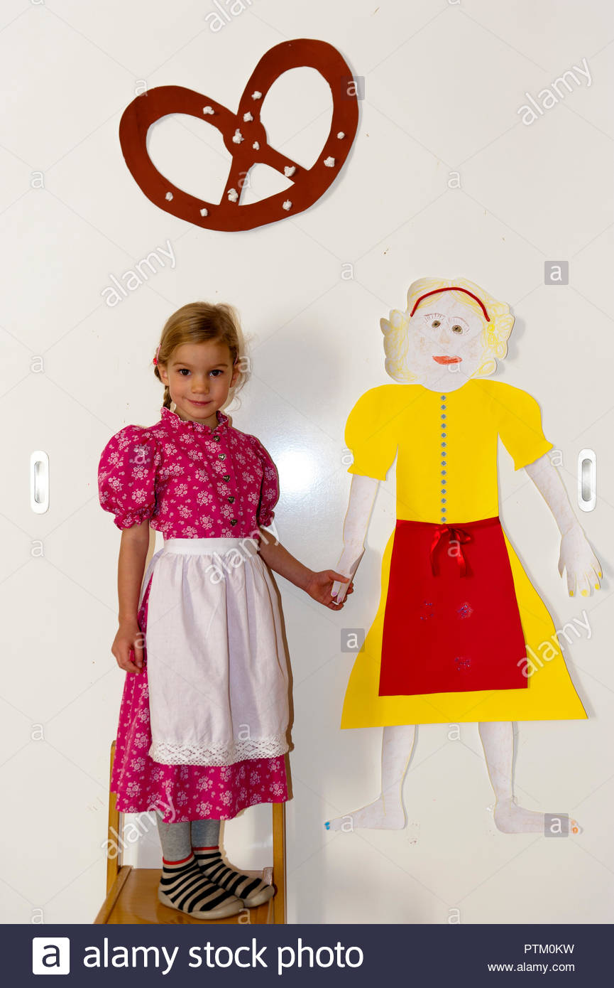 Little girl in a dirndl, in a kindergarten with a self-made girl, Munich, Bavaria - Stock Image