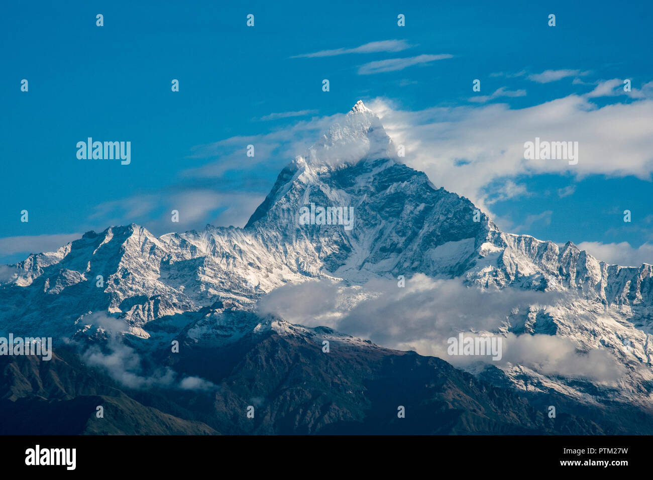 Mount Machapuchare or Fisthail peak near Pokhara in Nepal. - Stock Image