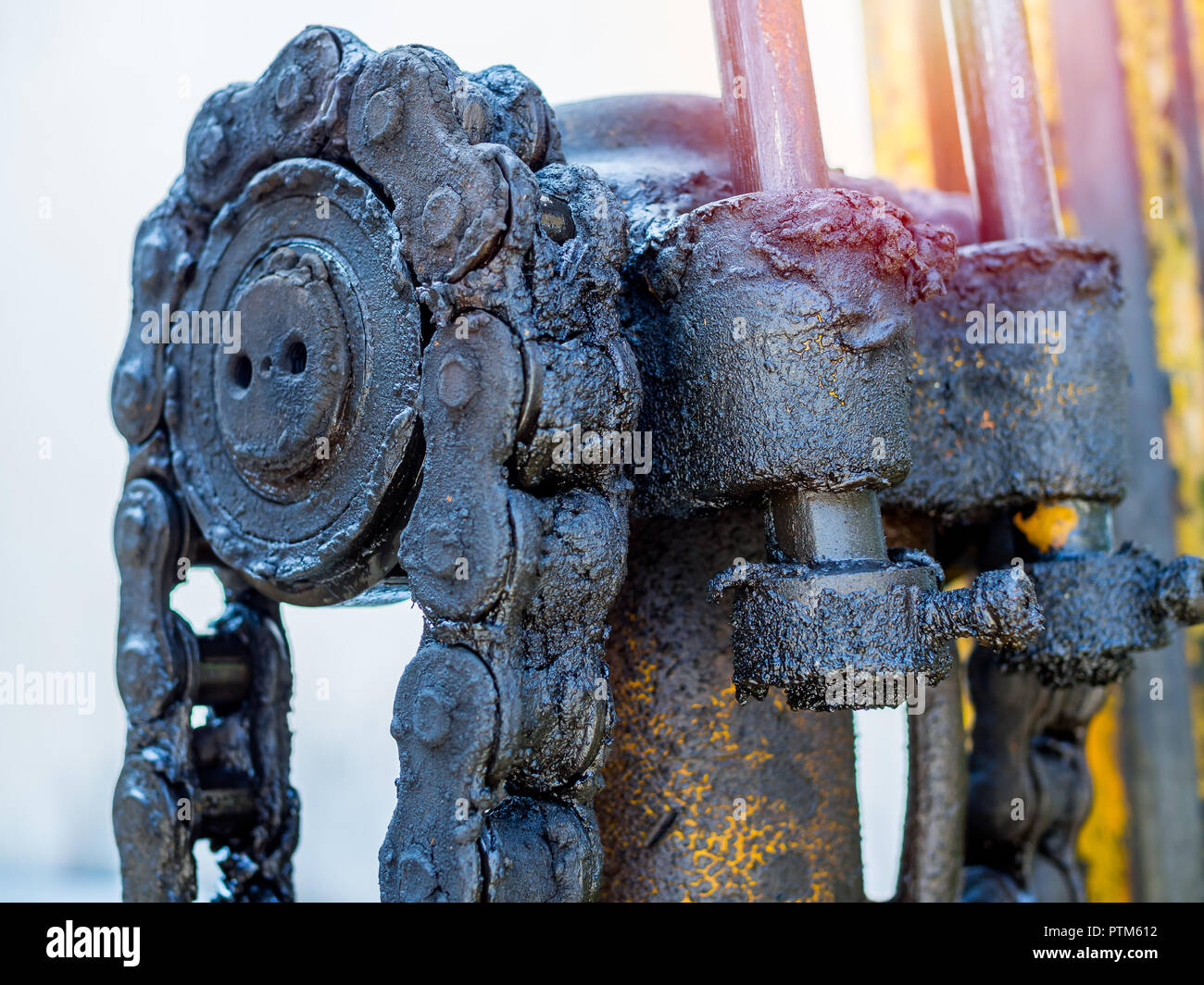 Close-up dirty and greasy chain of old forklifts with engine oil and