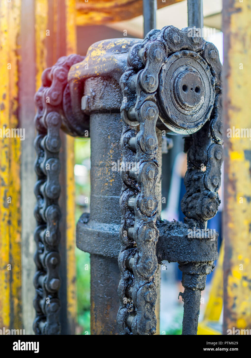 Close-up dirty and greasy chain of old forklifts with engine