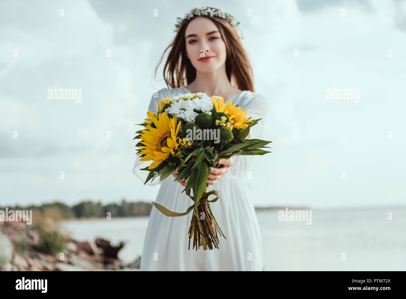 745b8a3bad beautiful elegant girl holding bouquet with yellow sunflowers Stock ...
