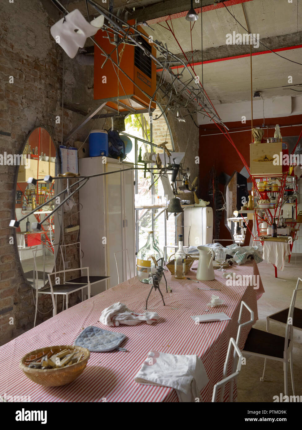 Dining room facing a garden in a a private house of a young artist in Milano, Italy Stock Photo